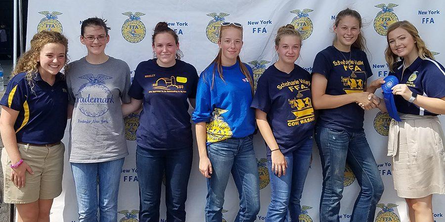 FFA students pose with ribbon at Fair