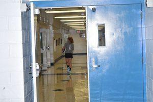student walking down high school hallway