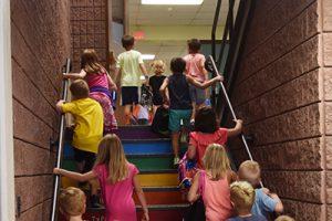 children climbing stairs in elementary school