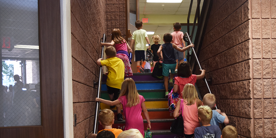 children climb stairs in elementary school