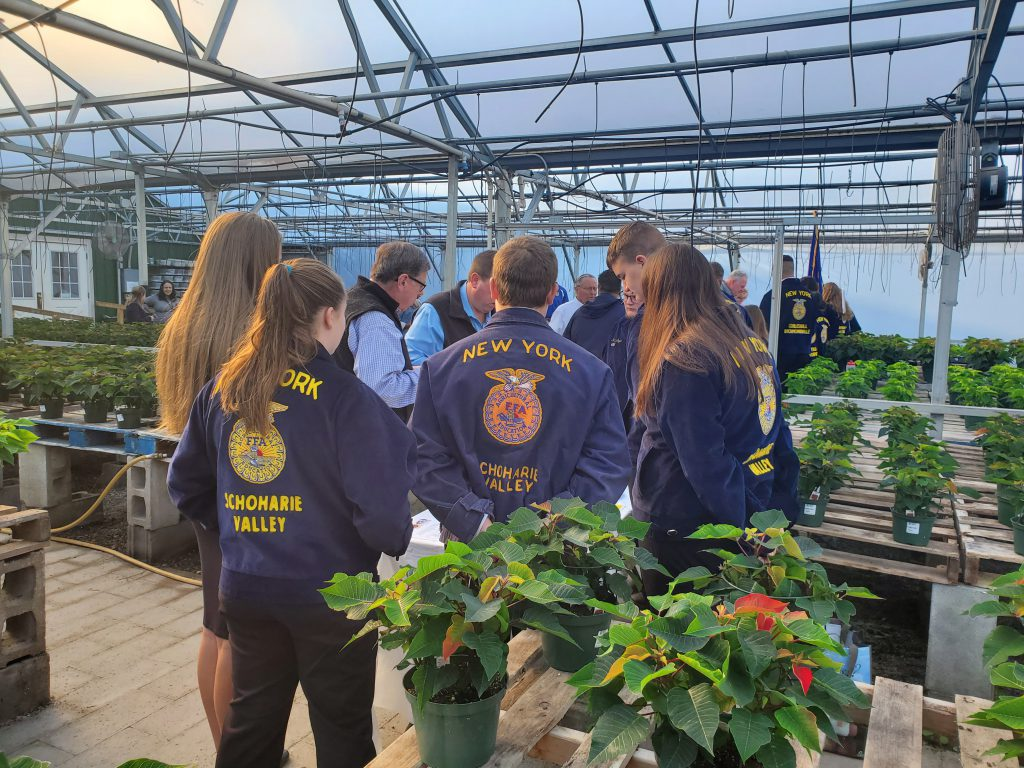Schoharie FFA members are seen inside a greenhouse