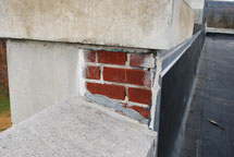 Crumbling parapet and mortar on roof