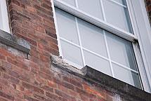 crumbling windowsill