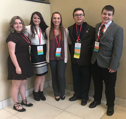 Jillian Rehberg, Jacquelyn Sullivan, Carissa Palmatier, David St. George, John Polley pose for group photo at conference