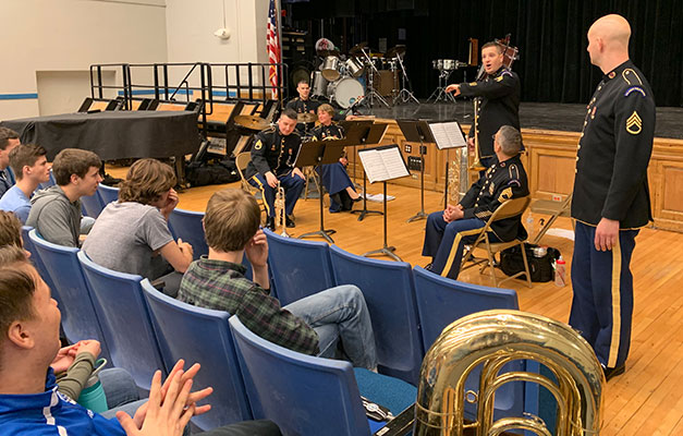 band member answers a question from seated students