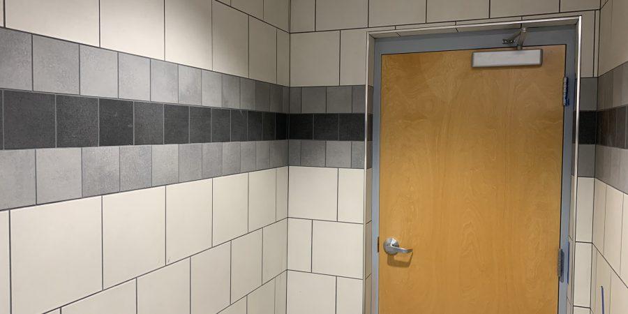 Bathroom tiles are seen