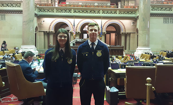 Jamie and Andrew standing in Assembly chamber