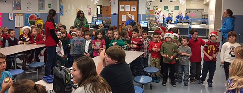 group of kindergartners caroling in lunch room