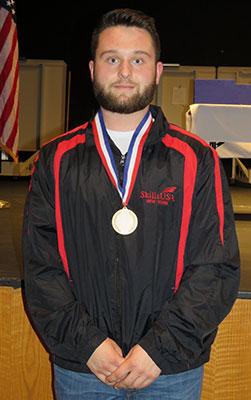 Mark Molesky wearing medal
