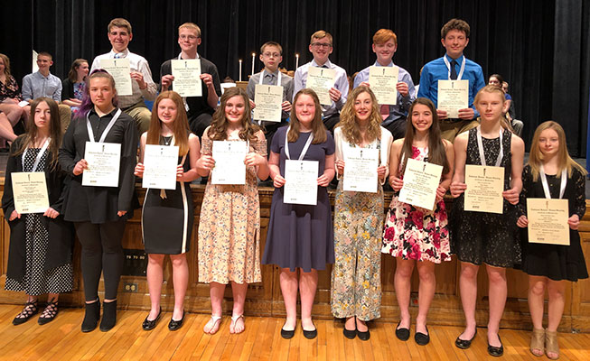 National Junior Honor Society inductees pose with their certificates