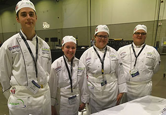 four student chefs in uniform