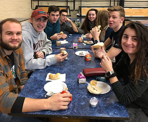 group of students sitting at breakfast table