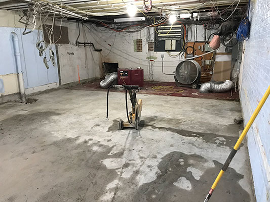 a gutted room in basement