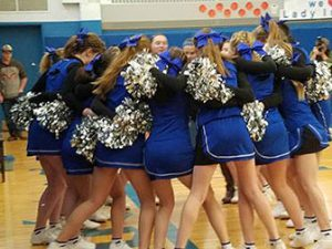 cheerleaders huddle together