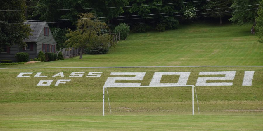 """The words """"class of 2021"""" are painted on a hill"""