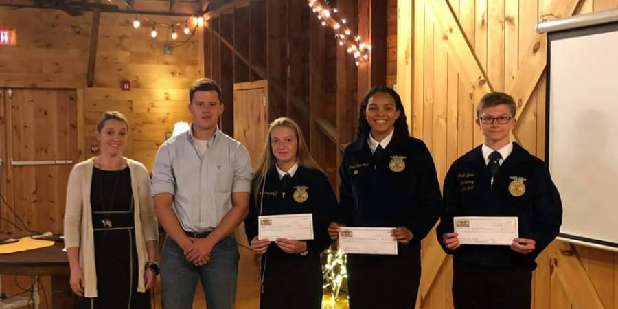 Four students and an adult stand halding certificates
